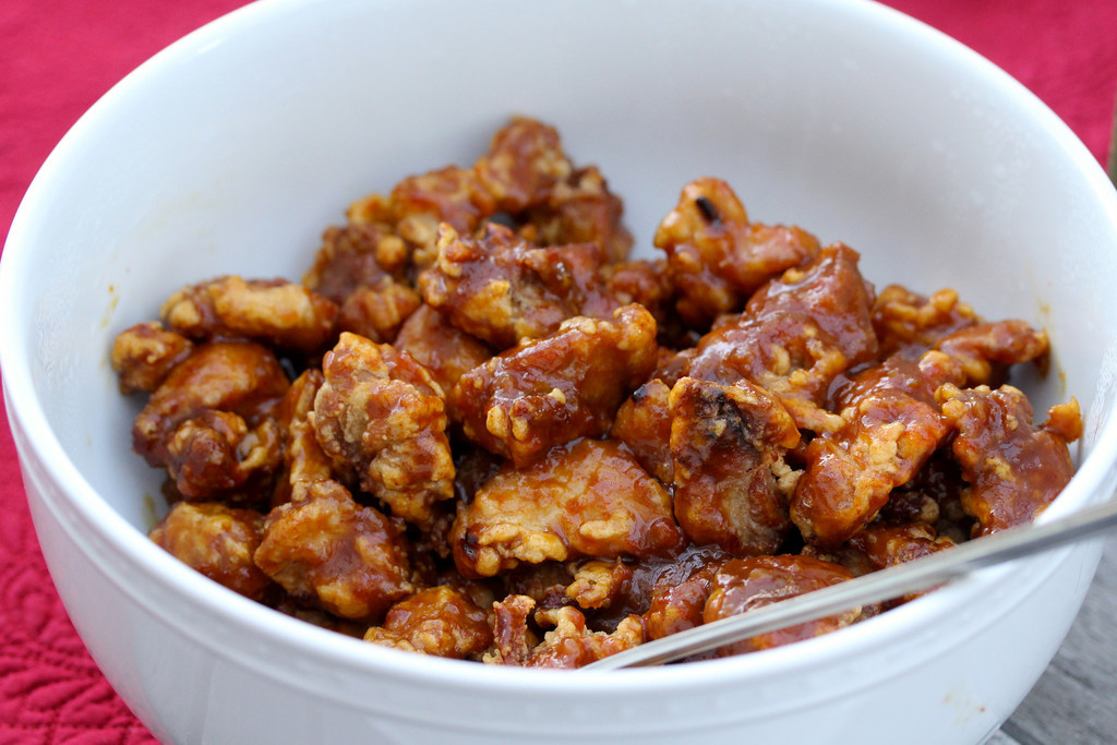 Orange Chicken in a white bowl from the blog Karen's Kitchen Stories