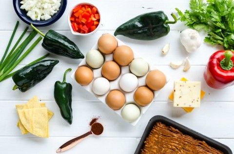 Ingredients for Overnight Mexican Breakfast Casserole laid out on a white background