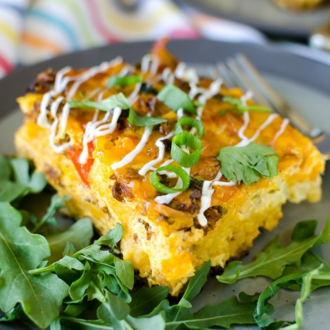 Overnight Mexican Breakfast Casserole on a bed of arugula on ShockinglyDelicious.com