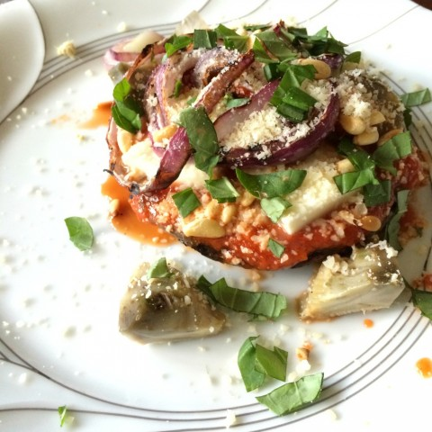 Portobello Pizza with Artichokes on a white plate on ShockinglyDelicious.com