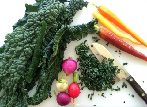 Chopping vegetables for Kale Salad with Apples, Carrots, Cheese and Capers
