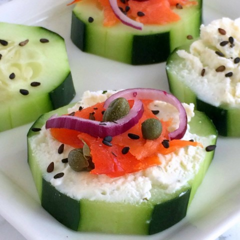 CUCUMBER SMOKED SALMON APPETIZER BITES: Crisp cucumbers are topped with garlic and herb cream cheese, smoked salmon and other garnishes that you might see on your Sunday bagel, for a light, flavor-packed appetizer that pairs beautifully with a fragrant white wine. #shockinglydelicious #appetizer #easyrecipe #smokedsalmon #cucumber #sponsored #cocktailparty #wineoclock