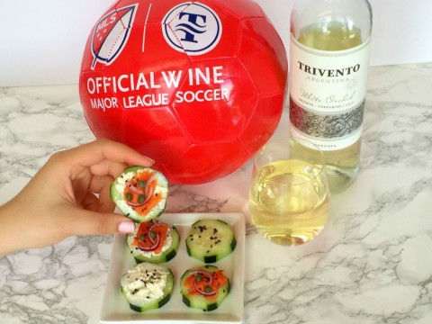 Cucumber Smoked Salmon Appetizer Bites with Trivento wine and a red soccer ball