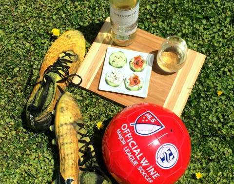 Cucumber Smoked Salmon Appetizers and wine with cleats and red soccer ball