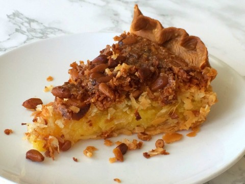 FRENCH COCONUT PIE WITH PINE NUTS: Tender coconut and toasty pine nuts baked into an egg filling perfumed with butter, vanilla, coconut and almond flavors, sparked with lemon zest.