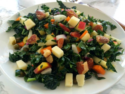 KALE SALAD WITH APPLES, CARROTS, CHEESE and CAPERS: Hearty enough to stand up to anything you serve with it, this easy-to-eat chopped salad has sweet, sharp, salty and crunchy notes, for a perfectly balanced forkful.