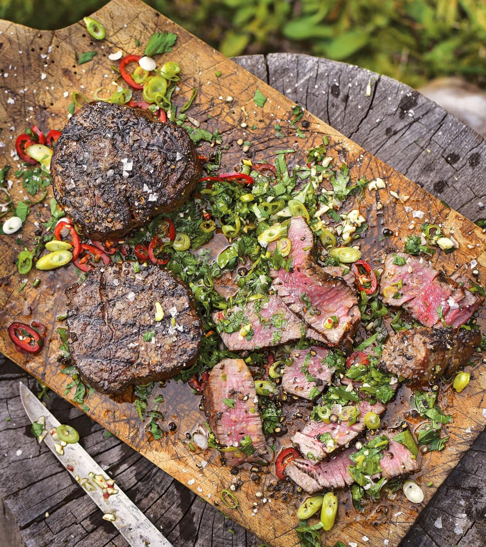 Filet Mignon with Cutting Board Sauce: The hot meat juices from the tender filet mignon steaks combine with the herbs and sauce ingredients right on the cutting board. As you cut the steak, it creates a sublime sauce.
