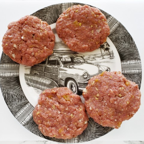 Island Pork Burgers shaped and on a surfer plate on ShockinglyDelicious.com