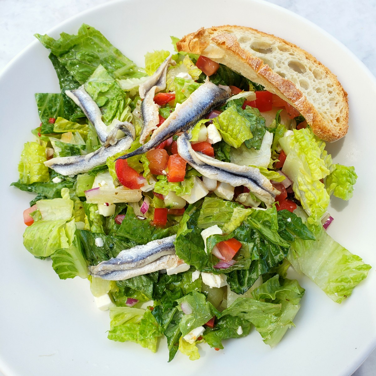 Mediterranean Salad with White Anchovies in a white bowl at The Sparrow Cafe in Malibu