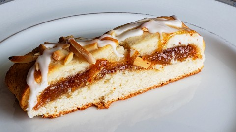 CREAM CHEESE PASTRY WITH ALMOND FILLING: Rich cream cheese pastry wraps sweet, sticky almond filling for an unforgettable brunch or evening dessert. A light glaze and crunchy almonds on top complete the treat.