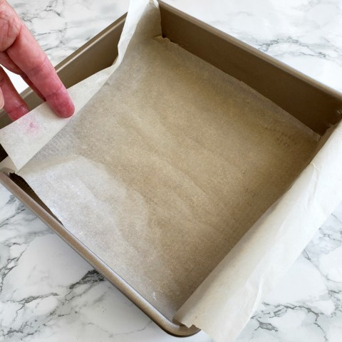 Butter the pan and line with parchment paper