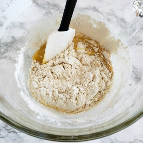 Stir flour and butter into eggs and sugar mixture with OXO spatula