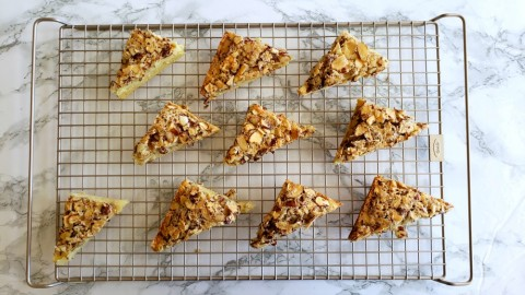 Swedish Visiting Cake Bars cut into triangles on an OXO cooling rack