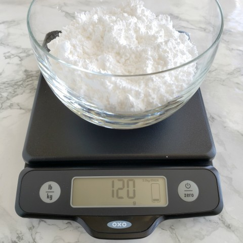 Weigh powdered sugar on the OXO scale