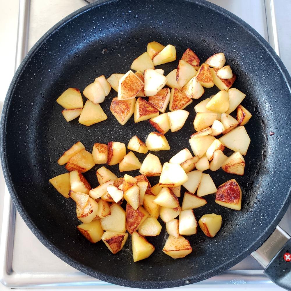 Browned apples in black skillet