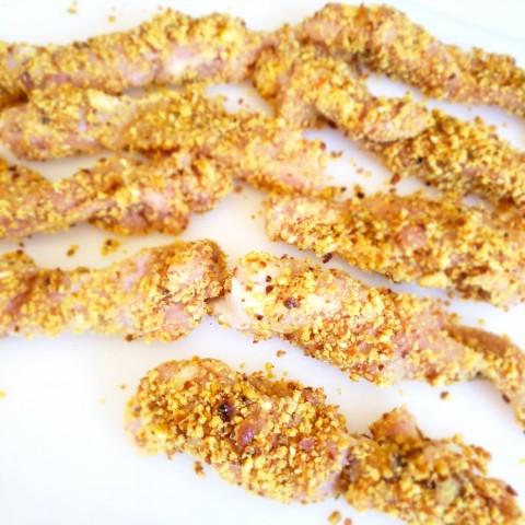 Chicken fingers breaded with pretzel crumbs