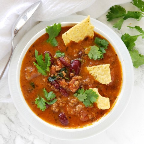 Instant Pot Bison Tortilla Soup in a white bowl