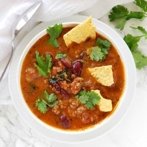 Instant Pot Bison Tortilla Soup in a white bowl