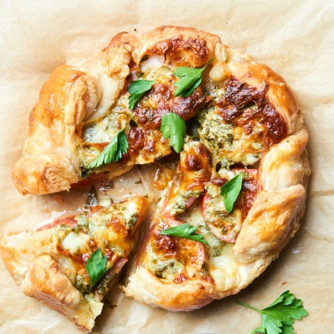A Tomato Galette is a free form savory tomato tart that brings the best ripe tomatoes to rest on a crispy crust, blanketed by herby, melty cheese. Whether you want a kid-friendly dinner, a date-night entree or are trying to impress at a dinner party, this delicious tart fits the bill.