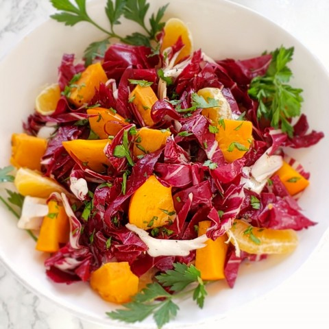 Radicchio and Roasted Sweet Potato Salad with Persimmons and Tangerines: So much color and flavor in an achingly beautiful salad that holds up well on a buffet table and will take you all the way through the holiday season in health!