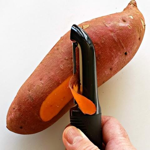 Peeling a sweet potato (yam) with an OXO peeler