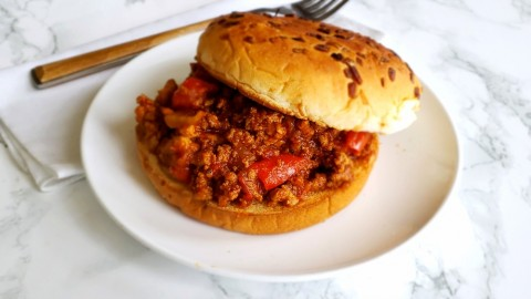 Slightly sweet & tangy, very meaty comforting Sloppy Joe on a soft, toasted onion bun. This easy recipe saves time by using an Instant Pot, on ShockinglyDelicious.com