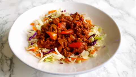 Low-Carb Instant Pot Sloppy Joes served over shredded cabbage on a white plate on ShockinglyDelicious.com