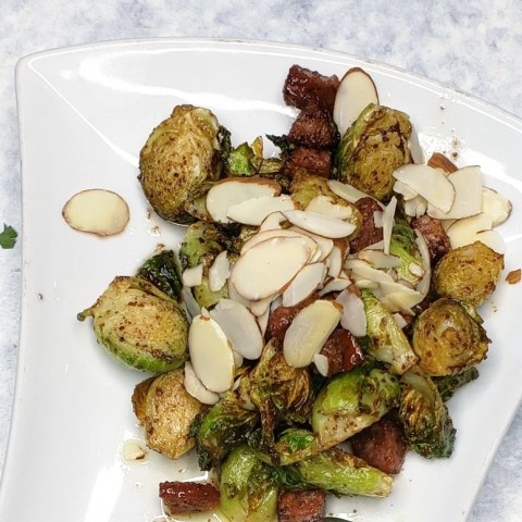 Brussels sprouts with chorizo and sumac vinaigrette on ShockinglyDelicious.com