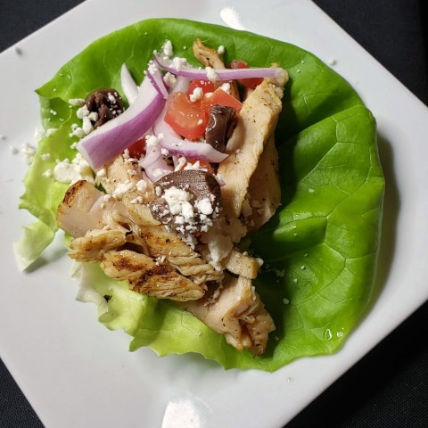 Mediterranean Taco on a lettuce leaf on a white plate from The Black Trumpet