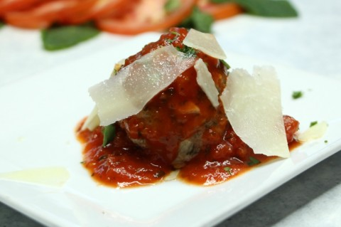 Veal Meatball with house marinara and shaved pecorino on a white plate on ShockinglyDelicious.com
