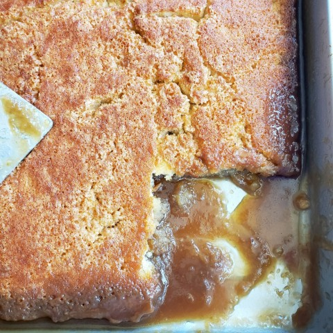 Caramel Sticky Pudding Cake with a piece cut out on ShockinglyDelicious.com