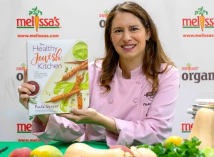Paula Shoyer holds her book The Healthy Jewish Kitchen