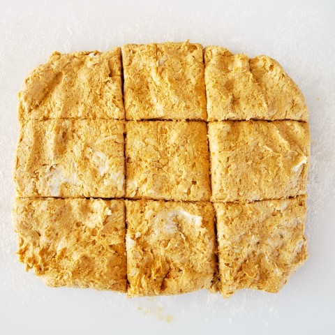 Cut dough into biscuit shapes on ShockinglyDelicious.com
