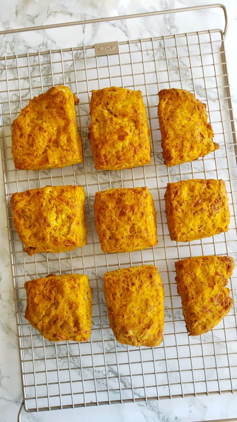 Pumpkin Cheddar Biscuits baked and out of oven on ShockinglyDelicious.com