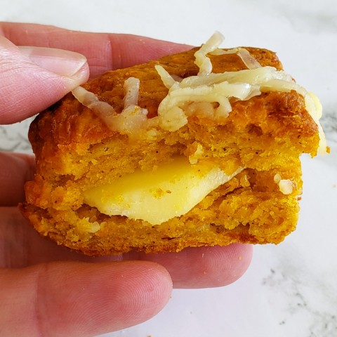 Pumpkin Cheddar Biscuits made into a cheese sandwich on ShockinglyDelicious.com