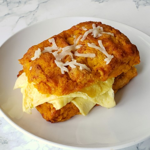 Pumpkin Cheddar Biscuits with scrambled egg inside for breakfast on ShockinglyDelicious.com