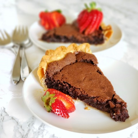 A cross between fudge and a wet brownie, this delicious blue-ribbon Old Fashioned Fudge Pie pie is a perfect foil for fresh berries or freshly whipped cream.