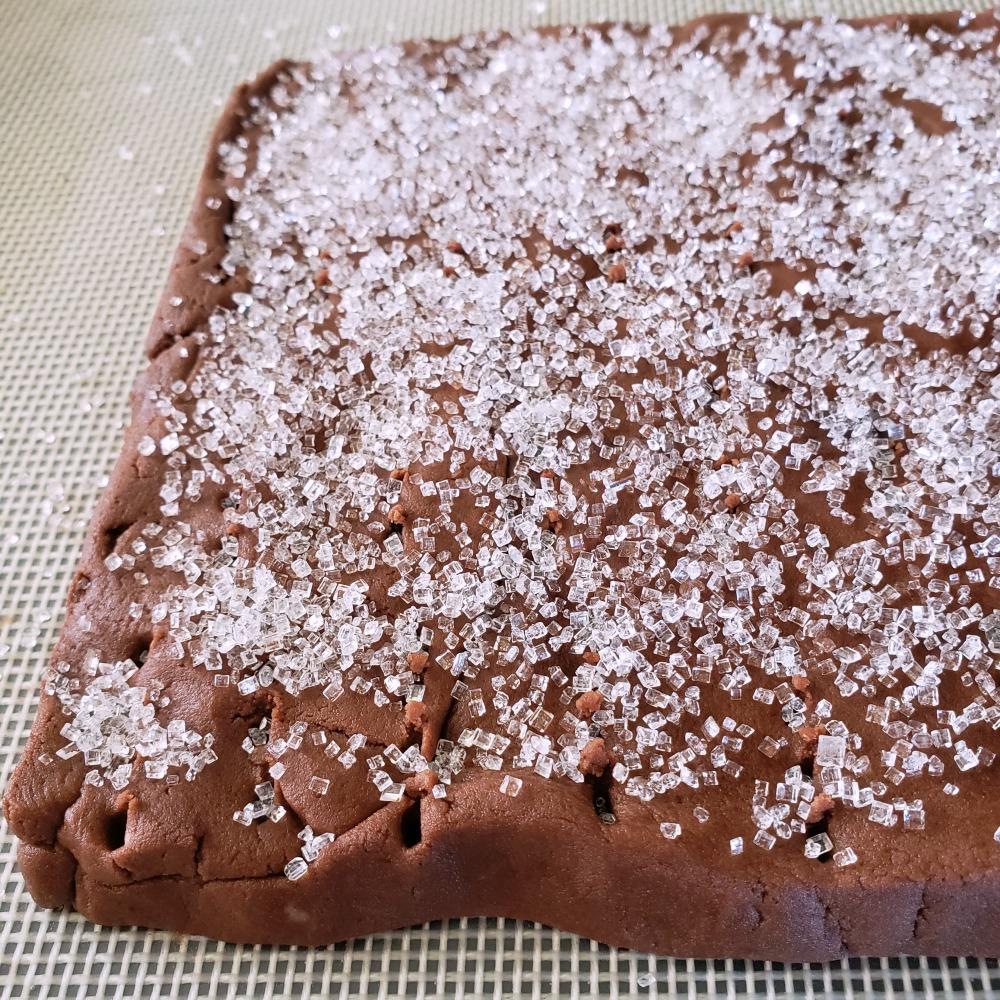Coarse sugar coats top of Rich Chocolate Shortbread Cookie dough on ShockinglyDelicious.com