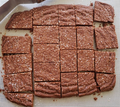 Cut Chocolate Shortbread Cookies while warm on ShockinglyDelicious.com
