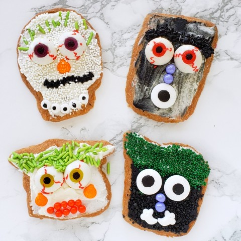 Shatteringly crisp Spooky Lemon-Vanilla Shortbread Cookies are decorated for Halloween time with colored icing, sprinkles and candy decorations. Scarier for older kids, more friendly-spooky for younger kids, and everyone gets a little shiver.