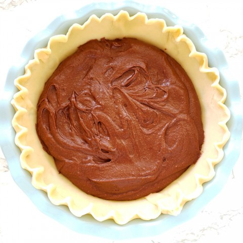 Spread batter in pie shell for Old Fashioned Fudge Pie on ShockinglyDelicious.com
