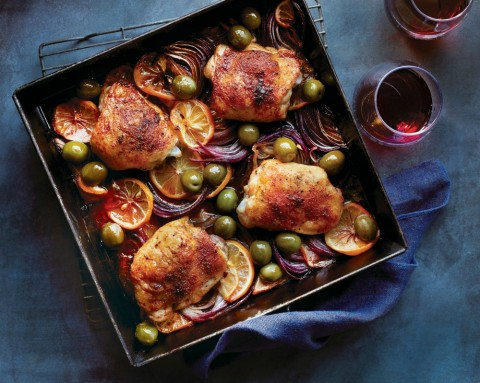 Roast Chicken Thighs with Meyer Lemon and Smoked Paprika: Meaty chicken thighs boast a deep orange color, roasting atop a succulent bed of red onion and sliced Meyer lemon.