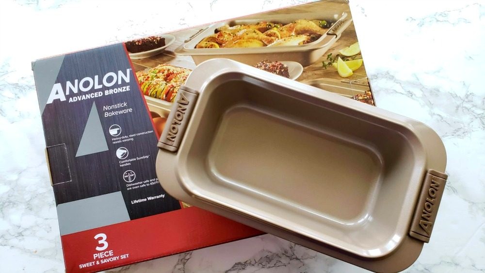 Box of Anolon 3-piece baking set, with loaf pan sitting on top
