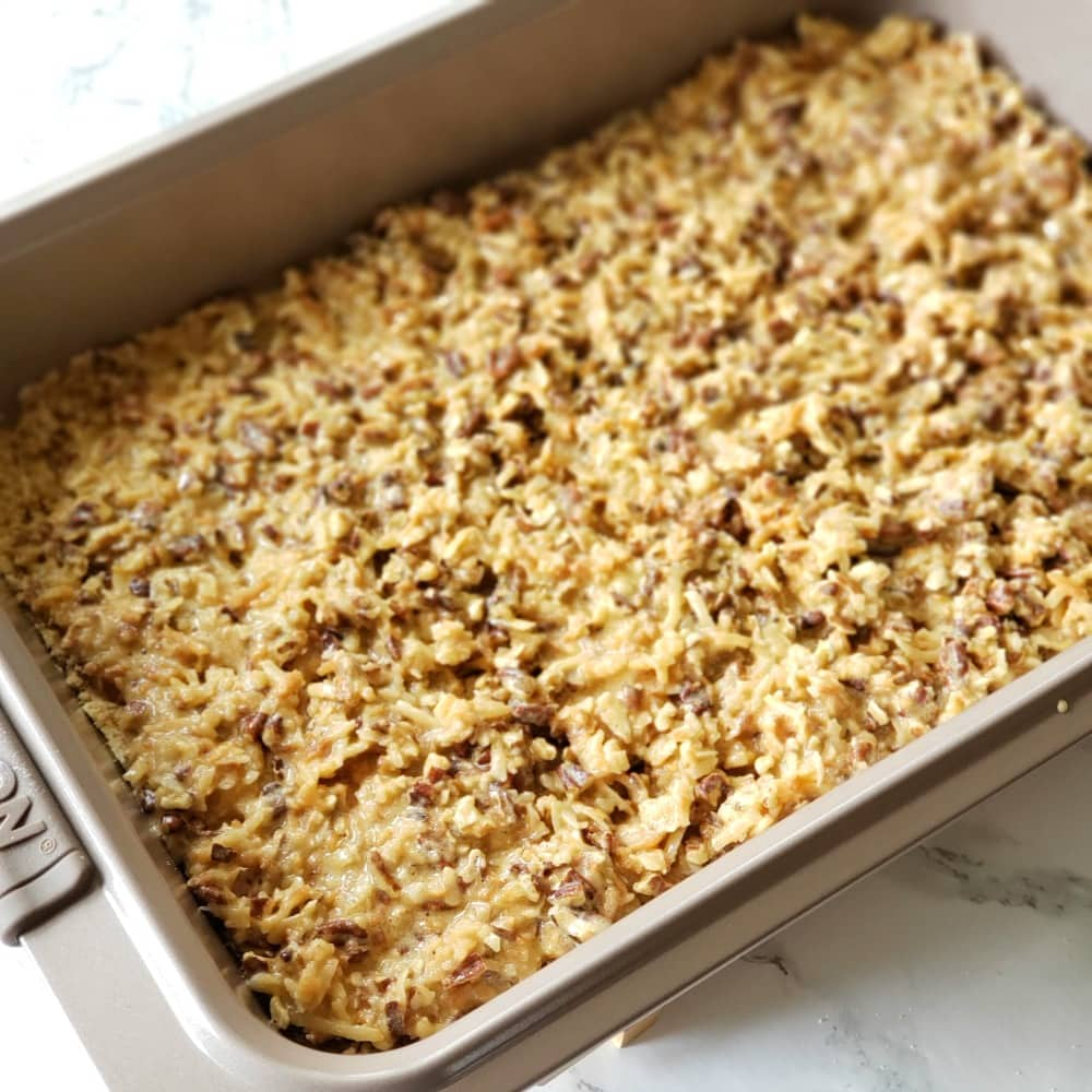 Pan of coconut bars ready to bake