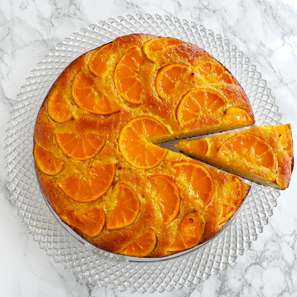 Greek Yogurt Tangerine Cake is one of the prettiest cakes around, and easiest, too! It's a simple cake made moist with yogurt and olive oil, and dressed with what turn into baked candied tangerine slices on top.