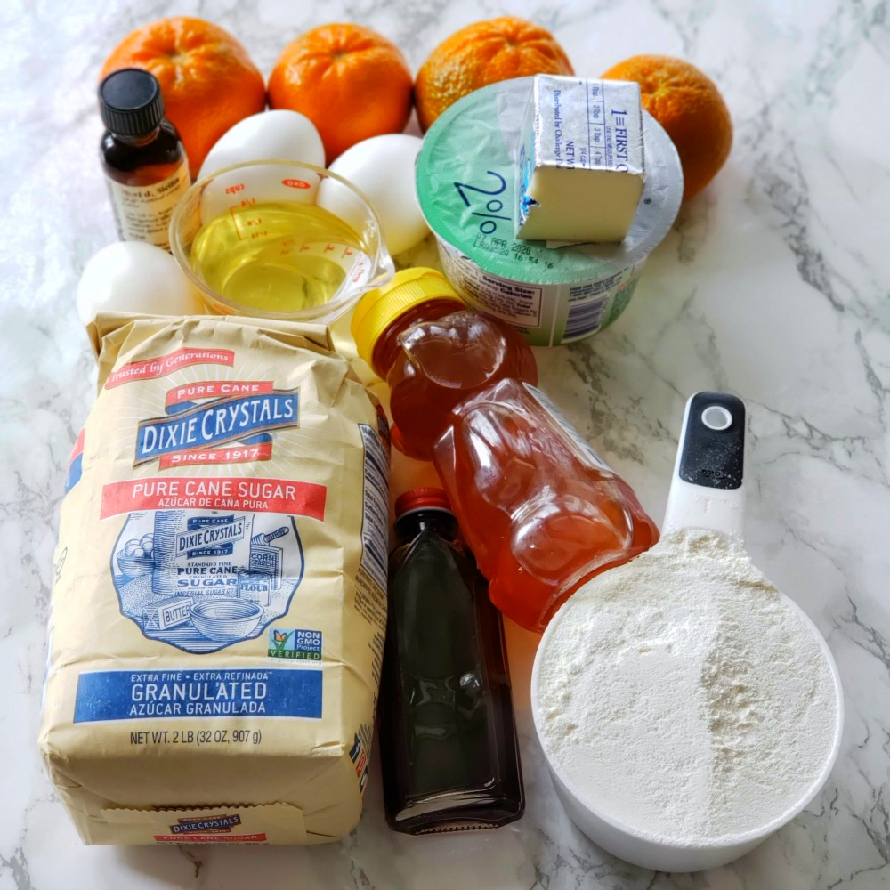 Array of ingredients on a white marble counter