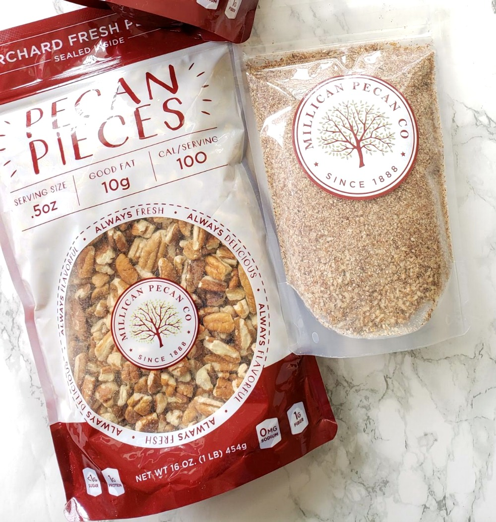2 bags of pecans on a white marble counter