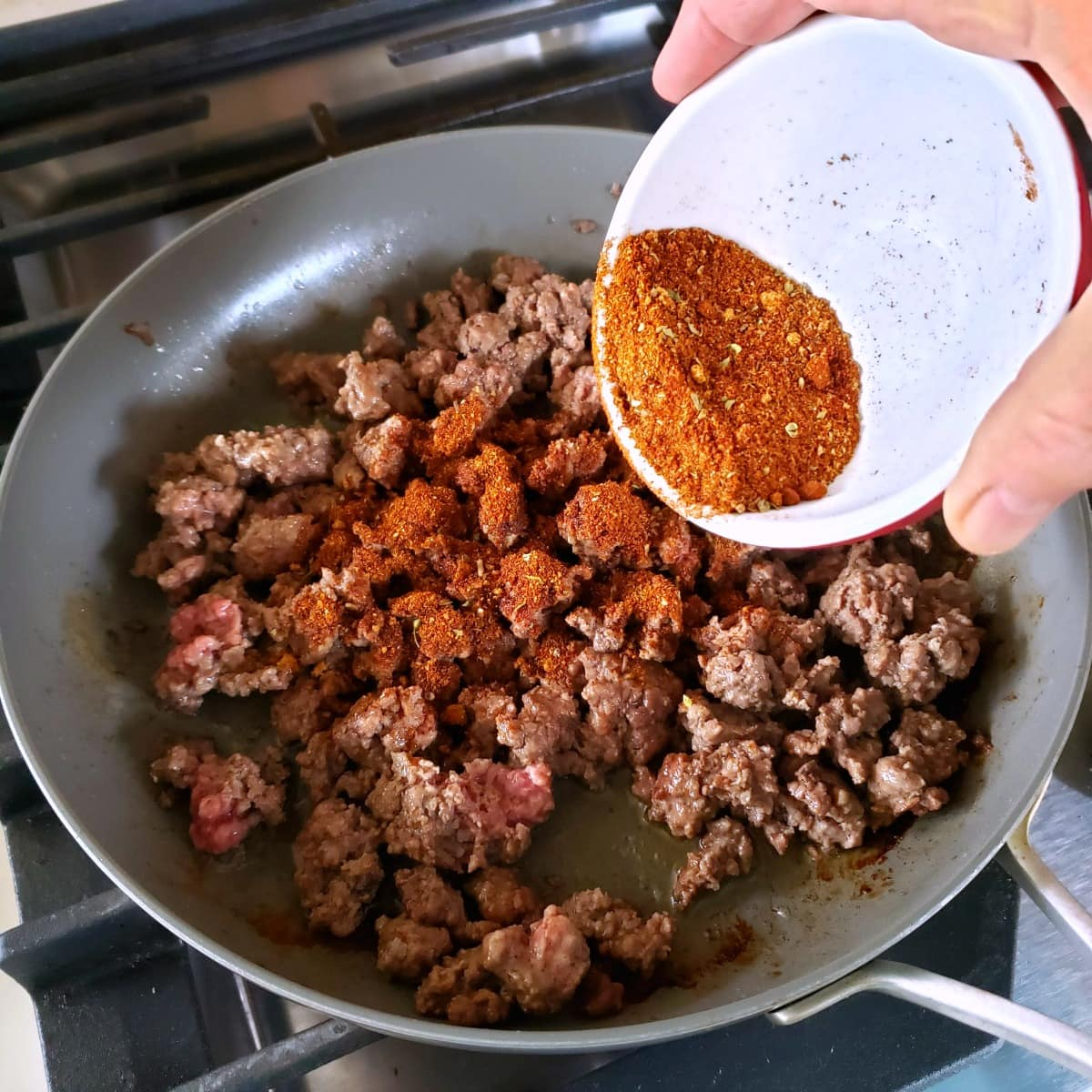 Add chili spices to the ground beef