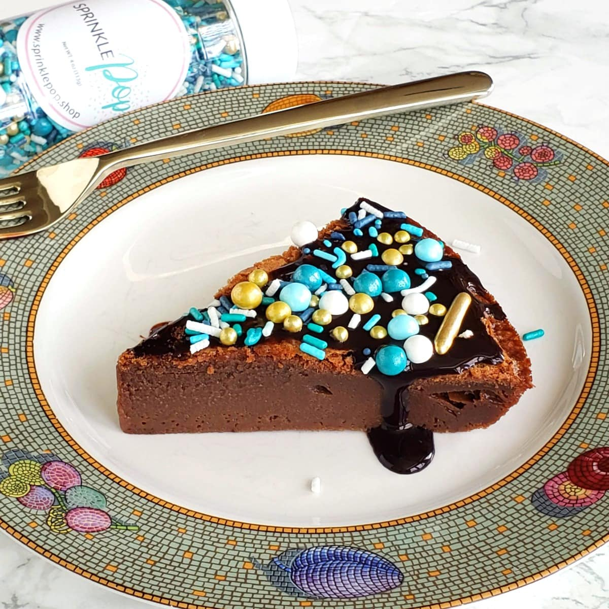 Chocolate Impossible Pie with sprinkles on top on ShockinglyDelicious.com