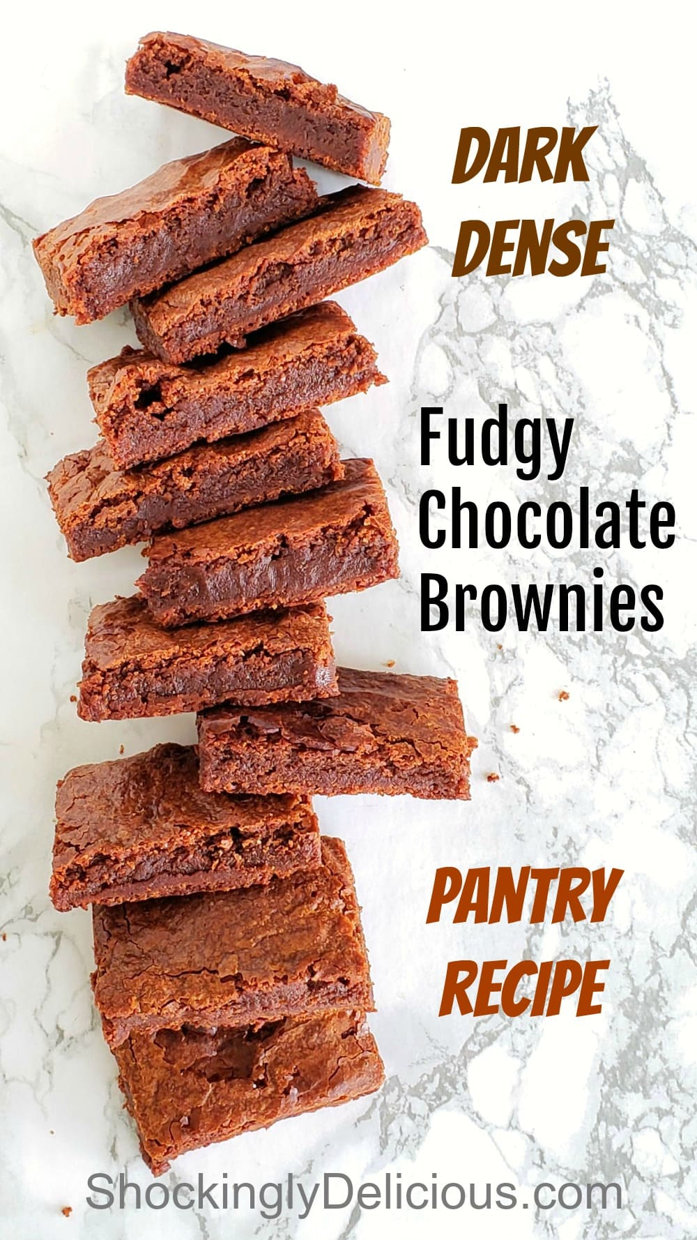 Fudgy Chocolate Brownies stacked on a marble counter top